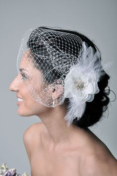 Hair Accessories Veil Bridal Fascinator Birdcage Veil -- KAT Birdcage Veil with Beaded Flower & Feathers for Wedding from Camilla Christine. $118.00, via Etsy.