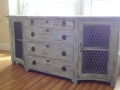 This is an antique piece that I hand painted and distressed. I added chicken wire for a unique rustic chic look. This piece comes with the original key that locks all drawers and the two side cabinets.This piece isnt in perfect shape as it is an antique piece. The top drawer has worn