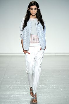Isabella in the white pant, white voile top, gray cropped vest, and grey perforated leather bomber jacket #SS13