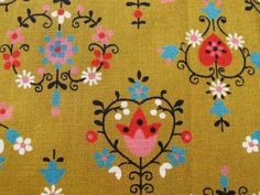 adorable folksy print but painted gold in the back ground!