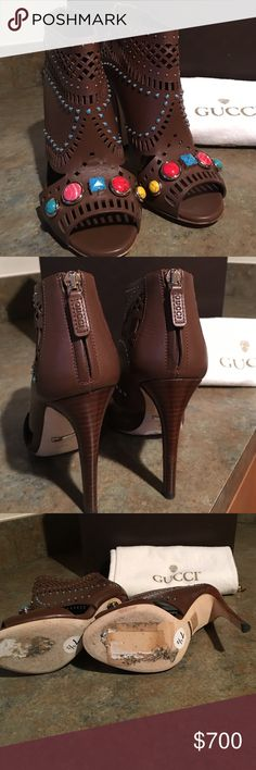 """GUCCI,""""BEADED""""HIGH HEELED ANKLE BOOT, LAST WEEK. Gucci, nut brown leather ankle boot.These sz.7 1/2 laser- cut boots have back zippers with leather Gucci pulls. With side cutouts and peep toes, these jeweled booties are perfect with jeans, slacks,leggings, & skirts and have 4 1/2in. heels. These dark nut brown boots are in pristine condition and where worn for 1 hour. They have slight wear on the soles and no stains, marks or damage, on the boots and no jewels are missing.Comes with 2 Gucci…"""