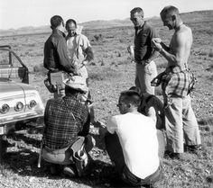 """Astronauts Alan Bean, Ted Freeman, Gene Cernan, Buzz Aldrin and Walt Cunningham take a break during geology training in 1964."""