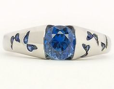 """The center sapphire is a """"Roulette' cut deep-medium blue sapphire with lots of flash and sparkle. The sapphire is set with open sides which allow a lovely side view of Andrew's beautiful faceting, from table to culet. Ring made by Eva Martin. Photo Jewelry, Jewelry Box, Jewelery, Fine Jewelry, Butterfly Ring, Fashion Rings, Women's Fashion, Pretty Rings, Thing 1"""