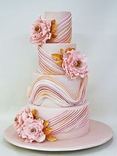 Pretty pink & gold wedding cake with ombre swirl detail and florl detail...     ᘡղbᘠ