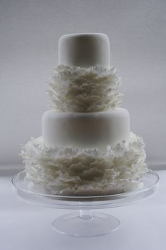 couture wedding cakes | Simple four tier white cake decorated with layers of delicate ruffles