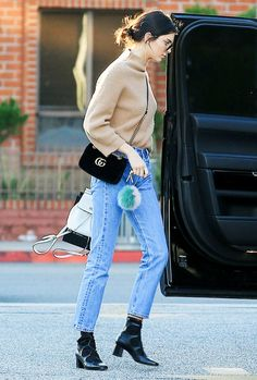 On Kendall Jenner:Garrett Leight x Mark McNary Sunglasses ($340);Gucci GG Marmont 2.0 Small Quilted Leather Shoulder Bag ($1890);Re/Done Slim Fit Jeans ($185).
