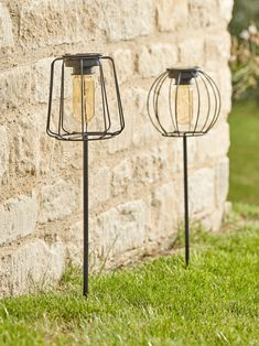 With a slender black frame, Cox & Cox set of two shaped stake lights are solar powered to bring a subtle twinkle to your garden. There are two cage designs in our set, each sitting atop a long, slender stem, with a stake point to secure into the ground.