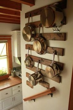 Attach hooks on the side of cupboards or cabinets that are empty. This gives you places to hang your kitchen utensils without having to have them shoved into one tiny drawer.