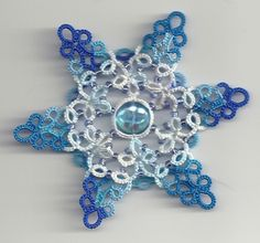 Three cups of tea into Tatting Tea Tuesday and enlightenment finally sets in.     Celtic Snowflake © Jane Eborall - 2012    Tatted by Is'Di...