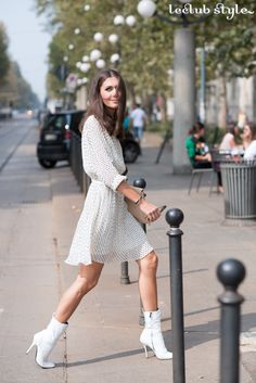 Womenswear Street Style by Ángel Robles. Fashion Photography from Paris Fashion Week. Diletta Bonaiuti wearing white boots and a summer dress between the shows, Milano.