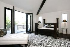 ohmygodddd. minus the busy carpet this room is adorable. i am OBSESSED with the french doors opening to outside !!