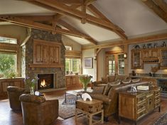 leather couches, exposed beams, stone fireplace