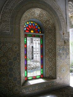 Classical zellige Tile work and stained glass, Morocco