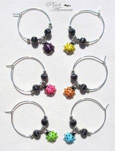 Perfect for Spring!  This set of 6 Wine Charms, featuring Metal Beads and Ladybug Charms is sure to be a hit at your next dinner party.  The ladybugs are painted varying colors so, when they're placed around your wine glass' stem, you can distinguish your wine glass from everyone else's.  Get them now, at the Pink Accents eBay Boutique!