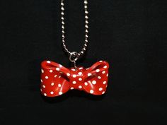 Red polymer clay bow.