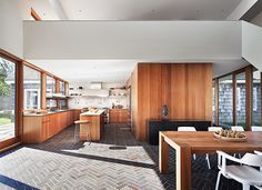 According to architects Christoff-Finio this double-height Sagaponack New York kitchen acts as a mediator between three 19th-century barns and a more modern bedroom wing. The firm describes the effect as that of a palimpsest where generations of building are layered one over the other.