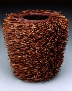 Christine Adcock. Porquepine Basket Description: coiled basket of dyed & split Torrey Pine needles, stitched with raw silk thread.Dimensions: H:10.00 x W:8.00 x D:8.00 Inches