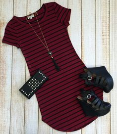 The On the Horizon Tunic Dress in Burgundy is striped, fitted, and oh so…