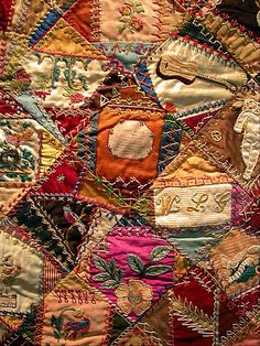 "I ❤ crazy quilting, & embroidery . Crazy Quilt I am so impressed by the embroidery on this quilt. Someone put in a printed piece (the one in the center here), entitled ""Love's Blessing. Crazy Quilting, Crazy Quilt Stitches, Crazy Quilt Blocks, Embroidery Stitches, Hand Embroidery, Embroidery Patterns, Art Textile, Quilt Stitching, Antique Quilts"