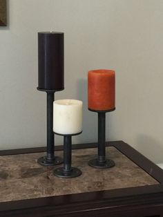 Industrial pipe candle holder ,Pillar candle holder set, candle stand set - Set of 3 - iron pipe, industrial, rustic, steampunk, modern, by RusticPipeCo on Etsy https://www.etsy.com/listing/469425775/industrial-pipe-candle-holder-pillar