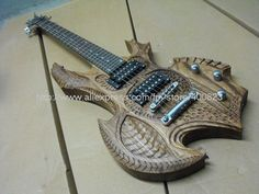 carved wood guitar...totally brutal