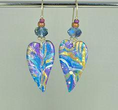 MISHA SEELHOFF | Long heart-shaped dangles.