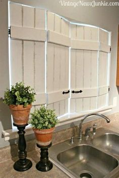 LOVE the shutters  LOVE the plant stands~How great do these diy kitchen shutters look, made from bed slats ~