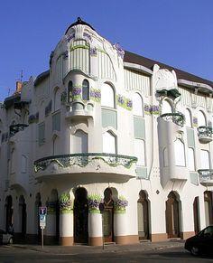 Art Nouveau in Hungary; Szeged, Reök Palace. Reök Palace is a mind-blowing green and lilac Art Nouveau structure built in 1907 that looks like an aquarium decoration. http://puszta.com/
