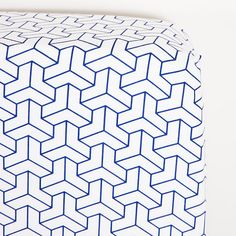 BABY COT SHEET SET  This navy blue inspired geometric sheet set brings colour to any modern nursery. Baby Boss cot sheet sets consist of a fitted and flat sheet, complete with a matching pillowcase. The flat sheet is bigger than your average size sheet offering extra width to tuck your babies in tightly. Featuring quality 250 thread count and 100% cotton providing a soft and gentle place to sleep like a baby.  Dimensions: Fitted Sheet - 135 x 77 x 19cm Flat Sheet - 160 x 140cm Pillow Case…