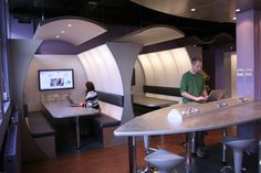 Pods in Durham University's Techno-Café, captured by jisc_infonet, on Flickr. Although appealing visually, this layout is not necessarily so comfortable as it requires students to twist to see the screen.