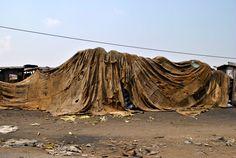 Un2013. Ibrahim Mahama (Ghana) Untitled, 2013. Draped jute sacks wall installation