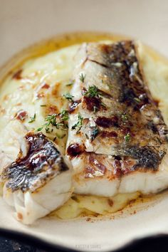 Grilled zander fillets on leek and potato puree