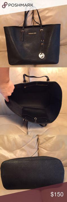 Authentic Michael Kors purse Authentic black Michael Kors purse! Good condition, has some wear on handles that's all Michael Kors Bags Totes