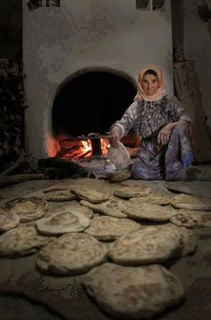 The old traditional bread making in a Village in Turkey. Republic Of Turkey, Turkish People, Working Woman, Working People, How To Make Bread, Bread Making, Turkish Recipes, Istanbul Turkey, World Cultures