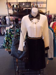Looking for a lady like way to wear leather to the office? Try this velour skirt and black and white blazer with pleather accents. Don't forget our CLEARANCE sale is still going on come in and get 50% off on some great styles before they're gone forever! At Clothes Mentor-Alliance Center!