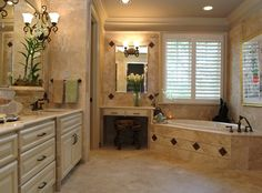 Built in vanity and corner bathtub....  ᗩᙡᕮᔕ〇ᙢᕮ .....  so I assume the huge shower is right around the corner ;)