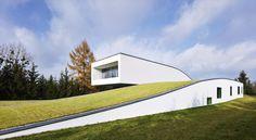 Auto-family house by KWK Promes Konieczny as Architects