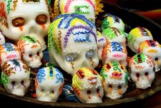 The skulls are so sweet. One popular tradition to make colorful candy made out of sugar. Often they are decorated with the names of the deceased on the forehead of the deceased on the forehead of the skull.  | 13 Things You May Not Have Known About The Day Of The Dead