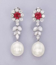 A PAIR OF SOUTH SEA CULTURED PEARL, DIAMOND AND RUBY EAR PENDANTS, BY BULGARI  Each set with a drop-shaped cultured pearl, measuring approximately 13.20 x 14.70 and 12.95 x 15.20 mm., to the marquise-cut and pear-shaped diamond flexible surmount suspended from a cushion-shaped ruby and circular-cut diamond cluster top, mounted in platinum  Signed Bulgari