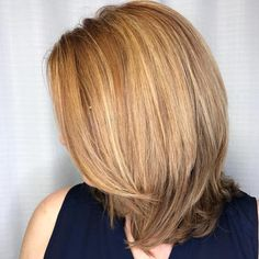 Medium Side-Parted Cut With Layered Ends
