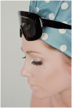 A model INA BALKE wears colossi sunglasses and a polka dot headscarf, 1964, Photographed By Gene Laurents