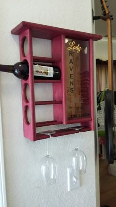 Purple heart wine rack with attached two glass hanger and cork display. Custom designed and hand built. JK FOREVER Designs. WWW.JKFOREVERDESIGNS.COM Custom Woodworking, Wine Rack, Cork, Custom Design, Hanger, Display, Purple, Storage, Heart