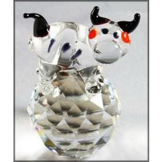 Crystal Cow Ornament. This fun Boda crystal figurine of a moo cow on a ball makes a great gift for kids or fabulous addition to your crystal ornament collection.
