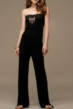 I want this so bad! My mom made a few like this in the 70's that were so amazing! Of course by the time I could wear them, I was too tall & she'd gotten rid of them. But I CAN wear this one!!      The jumpsuits crafted in dacron and cotton, featuring strapless design, exquisite ruched detail to the chest, medium fitted waistline, wide legs with long length cut.