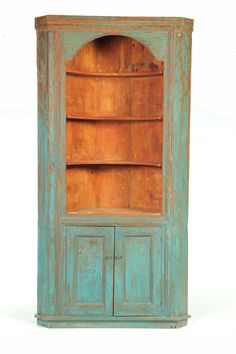 Pine corner cupboard with old blue paint, early 19th C., Garth's Auctions
