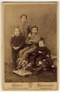 Vintage cabinet card four German brothers with toy horses