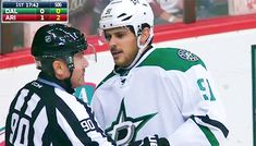 Tyler Seguin wipes the linesman's mask after fogging it up during a scrum