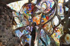 awesome window made from driftwood and stained glass