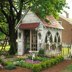 beautiful tiny garden shed / studio made with salvaged gothic style windows