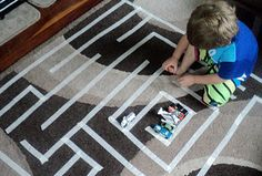 a maze with tape on a rug